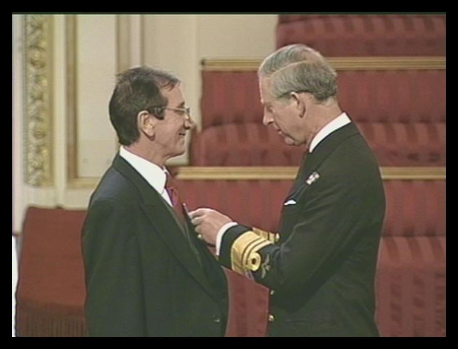 2004: David Booth receiving his MBE (Member of the Order of the British Empire) from Prince Charles at Buchingham Palace