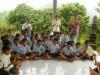Yeny, EBPP's music programme coordinator, brilliantly leads EBPP's Darmaji school kids