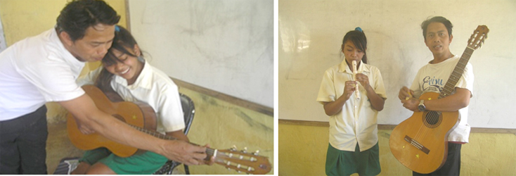 Wayan senin playing guitar with music teacher