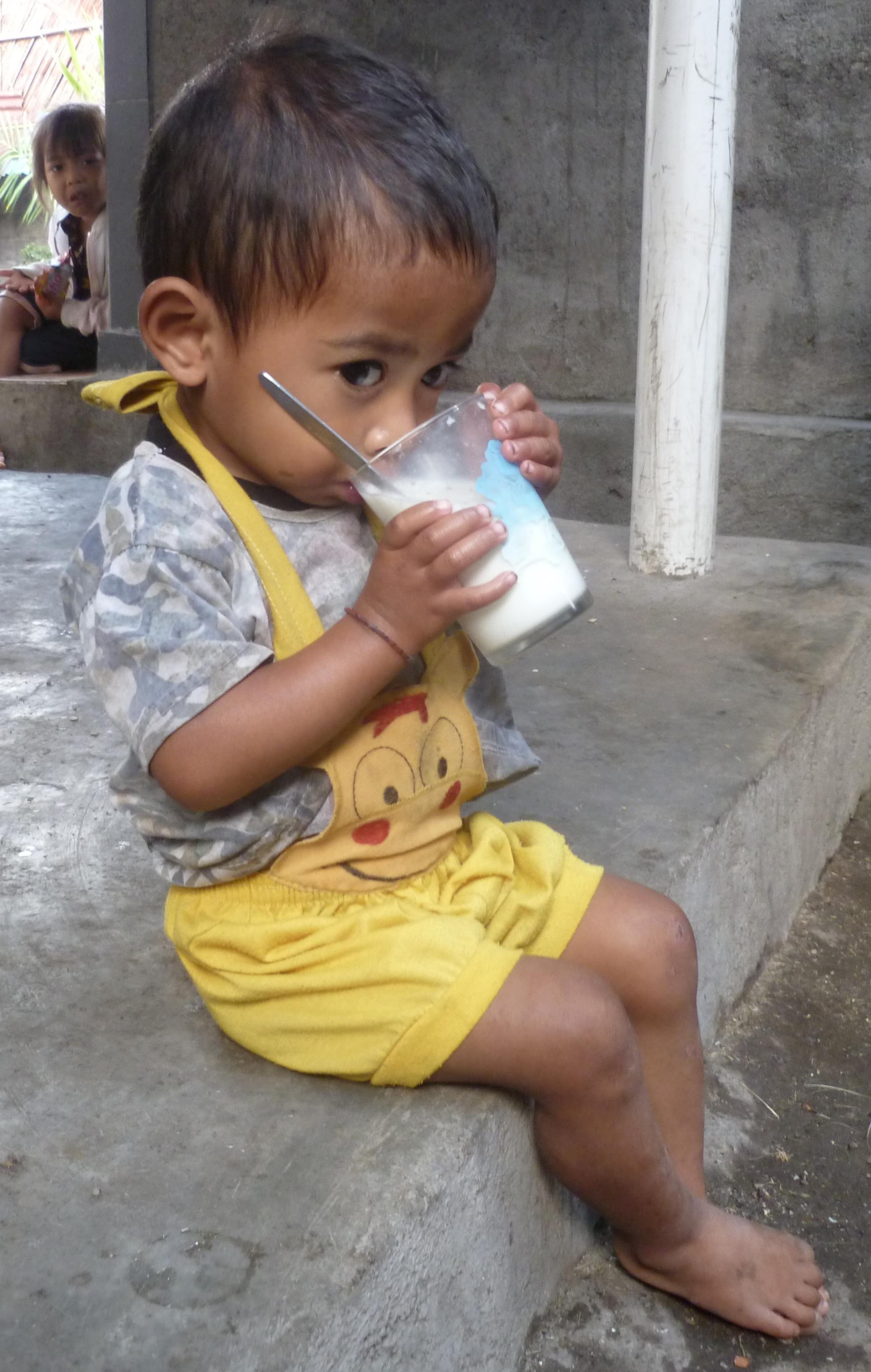 Gunawan drinking milk
