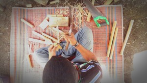 A man from the local EBPP Bamboo Team is working on various handicrafts.
